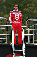 Dario Franchitti reflecting before the start of the NASCAR race in Memphis, at Memphis Motorsports Park.
