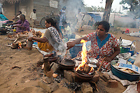 Women cooking hoppers and pittu along the street leading to the Kovil. Mamangeshwarar Temple festival.