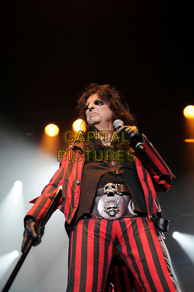Alice Cooper.Performing live in concert, Wembley Arena, London, England. .28th October 2012.on stage in concert live gig performance performing music half length black red shirt suit stripe gloves skull belt buckle .CAP/MAR.© Martin Harris/Capital Pictures.