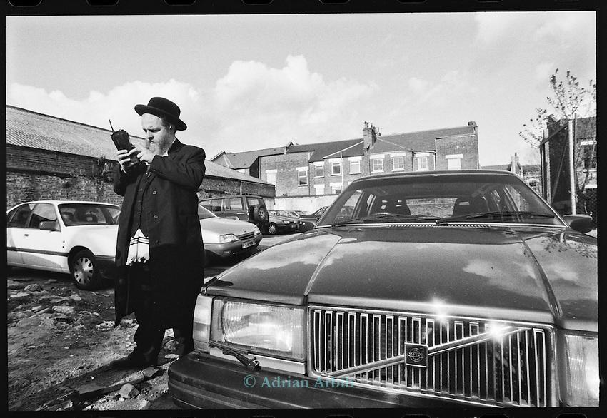 Zalmy, a car salesman in his yard,   Stamford Hill  North London