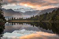 Sunrise at Lake Matheson with reflections of Aoraki Mt. Cook and Mt. Tasman, Westland Tai Poutini National Park, West Coast, UNESCO World Heritage Area, New Zealand, NZ