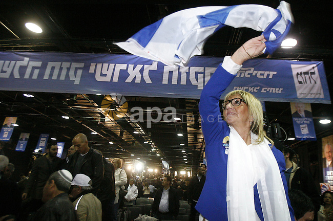 """Supporters of Israeli Prime Minister and chairman of the Likud party Benjamin Netanyahu party celebrate election results in Tel Aviv early on January 23, 2013 after his Likud-Beitenu list won the Israeli general election. Netanyahu said it was necessary to form the """"broadest possible government"""" after his Likud-Beitenu list won a narrow election victory, with the centrist Yesh Atid in second place. Photo by Mahfouz Abu Turk"""