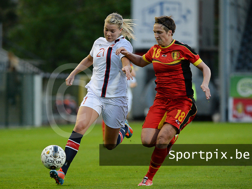 20140410 - LEUVEN , BELGIUM : Norway Ada Hegerberg (21) pictured with Belgian Maud Coutereels (18)  during the female soccer match between Belgium and Norway, on the seventh matchday in group 5 of the UEFA qualifying round to the FIFA Women World Cup in Canada 2015 at Stadion Den Dreef , Leuven . Thursday 10th April 2014 . PHOTO DAVID CATRY
