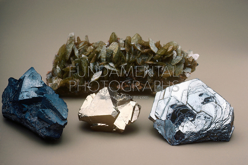 ORES OF IRON<br /> FeCO3, Fe3O4, Fe2O3, FeS2<br /> From left to right: magnetite (iron oxide), siderite (iron carbonate), hematite (iron oxide), and pyrite (iron sulfide).