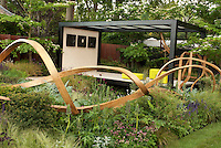 Modern Gazebo & Wooden fence sculpture in garden designed by Andy Sturgeon