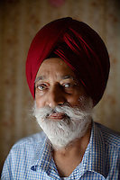 Dr. Harnek Bains is the leader of the Austin Gurdwara congregation.  He is photographed in the 1,200 square foot trailer that his congregation used for worship services beginning in 2003.