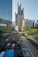 Garden Road, looking west; the modern HSBC headquarters towers cathedral-like over the older Bank of China building