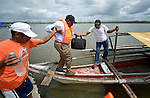John Nduna, the general secretary of the ACT Alliance, boards a boat in Salvacion en route to Jinamoc Island, both part of the municipality of Basey in the Philippines province of Samar that was hit hard by Typhoon Haiyan in November 2013. The storm was known locally as Yolanda. The ACT Alliance has been providing a variety of forms of assistance to survivors in the area, and Nduna and other ACT Alliance leaders spent several days in these and other affected communities learning first hand about the network's emergency response and long-term plans for recovery and rehabilitation.