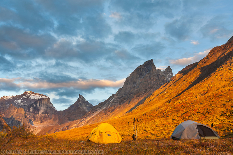 Campsite view of morning light on Xanadu, Arial and Caliban Peaks, in the Arrigetch Peaks, Gates of the Arctic National Park, Alaska.