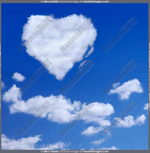 Heart shaped white cloud in blue sky