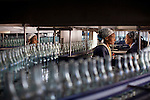 AMBO, ETHIOPIA - NOVEMBER 15: Bottles of mineral rich sparkling water is being made in this factory who was established 80 years ago in Sekele locality near a hot spring 130 km west of Addis Ababa on November 15, 2010 in AMBO, Ethiopia.The brand has about 85 percent of the market in the country. Recently new investments were made by the company and SAB Miller of 21 million USD. New products which are in the pipeline are called Ambo Plus, and they are orange- apple- pineapple- and lemon flavored Ambo water. ((Photo by Per-Anders Pettersson)