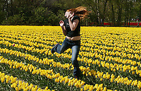 Cristin Bissonnette,15, of South Seattle, jumps up for a photo her boyfriend is taking in the tulip fileds along Best Road near La Conner. The Skagit Valley Tulip Festival continues through April.