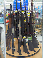 "USA. Arizona state. Prescott. The hypermarket Walmart sells semi-automatic rifles according to the u.S. federal law. Wal-Mart Stores, Inc., doing business as Walmart, is an American multinational retail corporation that operates a chain of hypermarkets, discount department stores and grocery stores all across the United States of America and abroad. A firearm is a portable gun, being a barreled weapon that launches one or more projectiles often driven by the action of an explosive force. Most modern firearms have rifled barrels to impart spin to the projectile for improved flight stability. The word firearms usually is used in a sense restricted to small arms (weapons that can be carried by a single person). The right to keep and bear arms is a fundamental right protected in the United States by the Second Amendment of the Bill of Rights in the Constitution of the United States of America and in the state constitutions of Arizona and 43 other states. The flag of the United States of America, often referred to as the American flag, is the national flag of the United States. It consists of thirteen equal horizontal stripes of red (top and bottom) alternating with white, with a blue rectangle in the canton (referred to specifically as the ""union"") bearing fifty small, white, five-pointed stars arranged in nine offset horizontal rows of six stars (top and bottom) alternating with rows of five stars. 26.01.16 © 2016 Didier Ruef"