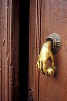 Brass hand-shaped door knocker, San Miguel de Allende, Mexico