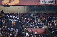FUSSBALL   INTERNATIONAL   UEFA EUROPA LEAGUE   SAISON 2012/2013    Achtelfinale Hinspiel VfB Stuttgart - Lazio Rom      07.03.2013 Lazio Fans mit der Fahne Curva Nord und ein Plakat Rosslau