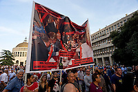 Rome, Italy  September 03, 2015<br /> Demostration anti-mafia, called by the centre-left Democratic Party,  at the church of Don Bosco in Rome to protest the ostentatious funeral of the purported Italian crime boss, Vittorio Casamonica, and to take a public stand against Italy's powerful crime syndicates. The Caravan of the Suburbs and the union Asia-USB, against the Democratic Party during the demonstration against the mafia, shouting&quot; Mafia Capital is within you. &quot;. Protesters with the photo of the dinner with members of the center-right of the center-left, with Casamonica.