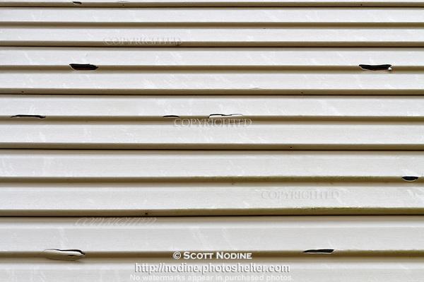 Vinyl siding severely damaged by hail scott nodine stock for Hail damage vinyl siding
