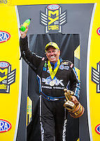 Sep 18, 2016; Concord, NC, USA; NHRA funny car driver John Force celebrates after winning the Carolina Nationals at zMax Dragway. Mandatory Credit: Mark J. Rebilas-USA TODAY Sports