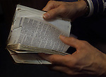Chaplain Bob Walter leafs through his bible which he keeps in his back pocket at all times when he is the Chapel of San Francisco General Hospital in California.
