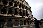 "Italy, Rome, November 5, 2011..A Italy demonstrator of the Centre-lef party (Democratic Party) carries a banner that reads ""Berlusconi human misery get out""while he takes part in a rally against the government of Italian Prime Minister Silvio Berlusconi at the at the San Giovanni square in Rome November 5 , 2011. VIEWpress / Eduardo Munoz Alvarez..Italy's opposition crowded few street of Rome during a rally on Saturday demanding Silvio Berlusconi's resignation, the opposition ""DP"" is accusing the prime minister of dragging the country into bankruptcy and global shame. International newspapers reported."