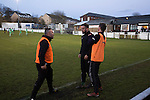 Bacup Borough 4 Holker Old Boys 1, 25/04/2016. Brain Boys West View Stadium, NorthWest Counties League Division One. Two opposing members of the backroom teams squaring up during an argument at the Brain Boys West View Stadium as Bacup Borough (in black) play Holker Old Boys in a NorthWest Counties League division one fixture. Formed as Bacup in 1879, the club moved into their current home in 1889 and have been known as Bacup Borough since the 1920s, apart from a brief recent spell when they added the name Rossendale to their name. With both teams challenging for play-off places, Bacup Borough won this fixture by 4-1, watched by a crowd of 50. Photo by Colin McPherson.