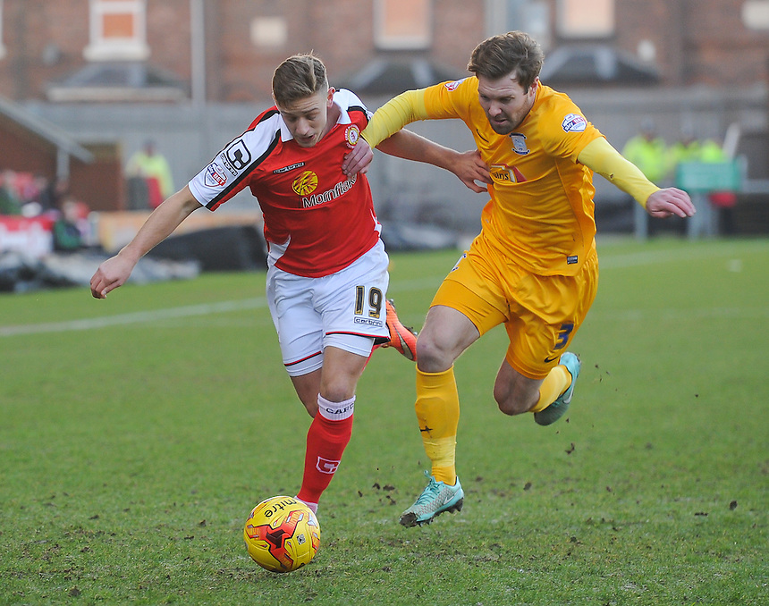 Crewe Alexandra's James Baillie is tackled by Preston North End's Scott Laird<br /> <br /> Photographer Craig Thomas/CameraSport<br /> <br /> Football - The Football League Sky Bet League One - Crewe Alexandra v Preston North End - Sunday 28th December 2014 - Alexandra Stadium - Crewe<br /> <br /> &copy; CameraSport - 43 Linden Ave. Countesthorpe. Leicester. England. LE8 5PG - Tel: +44 (0) 116 277 4147 - admin@camerasport.com - www.camerasport.com