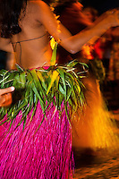Tahitian dancers with colorful grass skirts in motion