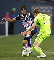 CF Monterrey forward César Delgado, left, battles Seattle Sounders FC defender Tyson Wahl for the ball during a CONCACAF Champions League match at CenturyLink Field in Seattle Tuesday Oct. 18, 2011. CF Monterrey won the game 2-1.