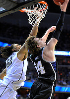 Matt Howard of the Bulldogs shoots a reverse layup against Panthers' Gary McGhee. Butler upset no.1 seed Pittsburgh 71-70 during the 3rd round of the NCAA Tournament at the Verizon Center in Washington, D.C on Saturday, March 19, 2011. Alan P. Santos/DC Sports Box