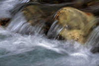 An intimate view of the upper section of the river Gesso in the Alpi Marittime Natural Park in Piedmont, Italy. A simple but dynamic composition about water flowing on rocks.