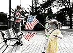Aryeh (5), Binyamin (5) and Sarah (3) Kramer playing with American Flags at Independence Day annual reading of the Declaration of Independence on Wednesday, July 4, 2012, held by Historical Society of the Merricks, Long Island, New York, USA. Volunteers each read one line from the historic document in this Long Island tradition.