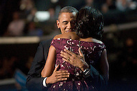 CHARLOTTE, NC - September 6, 2012 - Barack Obama hugs Michelle Obama prior to his remarks at the 2012 Democratic National Convention.