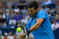 NEW YORK, USA - SEPT 11, Novak Djokovic of Serbia returns a shot against Stan Wawrinka of Switzerland during their Men's Singles Final Match of the 2016 US Open at the USTA Billie Jean King National Tennis Center on September 11, 2016 in New York.  photo by VIEWpress