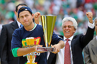 Mighel Sabah of Mexico (MEX) holds the Golden Boot award as Justino Compean, President of the Mexican Football Association celebrates. Mexico (MEX) defeated the United States (USA) 5-0 during the finals of the CONCACAF Gold Cup at Giants Stadium in East Rutherford, NJ, on July 26, 2009.