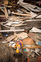 A doll amidst debris from the March 11 tsunami, Ishinomaki, Miyagi Prefecture, Japan, May 5, 2011. Almost two months after the devastating earthquake and tsunami the reconstruction has barely begun.