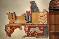 Detail of wall painting (20th century copy), showing a dromedary (right), a fantastic creature (left fragmented) and Saints (above), Lombard Romanesque style Church of Sant Joan de Boi, 11th century, Catalonia, Spain. On the undersides of arches and in the lower part of the church are murals representing the Medieval bestiary, a mix of known animals and fantastic beasts. The murals are now preserved at the National Museum of Catalan Art (MNAC) in Barcelona. Picture by Manuel Cohen.
