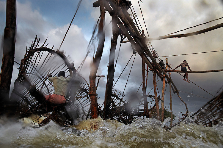 Fishermen navigate wooden frames over Wagenia Falls on the left bank of the Congo River, near Kisangani, DR Congo. The left bank consists of largest series of wooden frames stretching across a fast body of water.