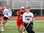 CHESHIRE, CT-042517JS15- Cheshire's Mia Pulisciano (14) runs the ball past Branford's Morgan Gilman (22) during their game Tuesday Cheshire High School. <br /> Jim Shannon Republican-American