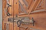 Door lock and door handle in the shape of a snake in Tirano, Italy