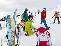 "Switzerland. Canton Valais. Russian snowboarder and skiiers in Verbier at  "" La Chaux"" ( 2260 meters ). Verbier is a village located in the municipality of Bagnes in the Val de Bagnes. Verbier is one of the largest holiday resort and ski areas in the Swiss Alps. Russian tourists. Woman standing on her knees. 3.01.2012 © 2012 Didier Ruef"