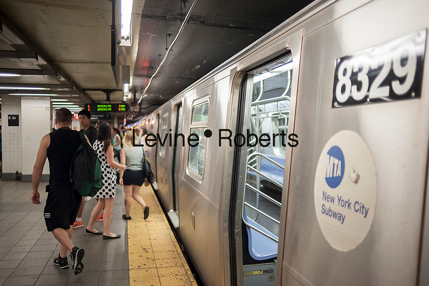"""Passenger disembark an """"L"""" train at its Eighth Avenue terminal in New York on Monday, July 25, 2016. Because of salt water damage to the Canarsie tunnel from Hurricane Sandy the MTA will close the line down in Manhattan for 18 months affecting hundreds of thousands of commuters. Trains will end at Bedford Avenue and the shutdown will start in 2019. ( © Richard B. Levine)"""