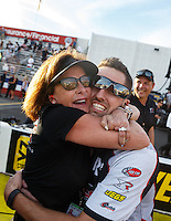 Feb 14, 2016; Pomona, CA, USA; Gary Pritchett , crew member for NHRA top fuel driver Steve Torrence (not pictured) celebrates with Kay Torrence during the Winternationals at Auto Club Raceway at Pomona. Mandatory Credit: Mark J. Rebilas-USA TODAY Sports