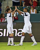 CARSON, CA – August 27, 2011: Real Salt Lake forward Alvaro Saborio (15) is congratulated on this goal by teammate Will Johnson (8) during the match between Chivas USA and Real Salt Lake at the Home Depot Center in Carson, California. Final score Chivas USA 0, Real Salt Lake 1.