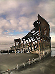 Shipwreck on a beach with rust