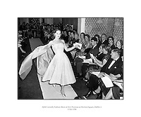 Sybil Connolly Fashion Show at New Premises at Merrion Sq..17/01/1958..Sybil Connolly (24 January 1921, Swansea, Wales - 6 May 1998, Dublin) was an Irish fashion designer for Brunschwig &amp; Fils, F. Schumacher &amp; Co., Tiffany &amp; Co., etc. She was named to the International Best Dressed List Hall of Fame in 1965..Sybil Connolly was born to a Welsh mother and an Irish father; they moved to County Waterford, where she was educated at a convent school run by the Sisters of Mercy. Her interest in fashion led her to London, aged 17, to study dressmaking with Bradley &amp; Co..Her clothes were sought after in the United States and she had an impressive list of clients from prominent families such as the Rockefellers, Mellons and Duponts, to famous actresses of the day. Jacqueline Kennedy wore a Sybil Connolly creation when she sat for her official White House portrait and visited the designer in Ireland. A showcase for her excellent taste in interior decoration, her home was featured in House Beautiful in 1967.[citation needed].In the 1980s, Sybil Connolly began designing for luxury goods makers Tiffany &amp; Co of New York, Tipperary Crystal, Brunschwig &amp; Fils, and Schumacher. Connolly lived at 71 Merrion Square in Dublin for many years and died there in May 1998. Considered one of Dublin's finest Georgian Squares, Merrion Square was first laid out in 1762 and mostly completed by the beginning of the 19th century. Now home to a number of prestigious organizations, including the Irish Red Cross, the National Gallery of Ireland and the National Museum of Ireland, the square was mainly residential up until the 1960s. The square boasted a number of notable residents during its history, including Oscar Wilde at No. 1, the poet William Butler Yeats at No. 82, and at No. 58, Daniel O'Connell, an Irish politician and campaigned for Catholic emancipation..She returned to Ireland at the outbreak of World War II and lived there for the rest of her life, making her home at number 71 Merrion Squa