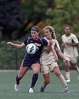 Pepperdine University forward Anisa Guajardo (10) controls the ball as Boston College midfielder Kate McCarthy (21) pressures. Pepperdine University defeated Boston College,1-0, at Soldiers Field Soccer Stadium, on September 29, 2012.