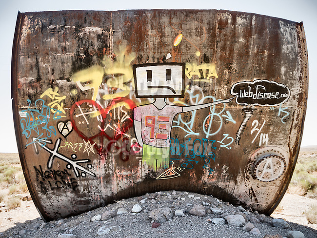 Graffiti on abandoned and rusty water tank, Salisbury Wash, Nev.