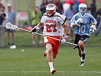 Virginia Cavaliers Scott McWilliams (27) runs in front of Johns Hopkins Greg Edmonds (10) during the game in Charlottesville, VA. Johns Hopkins defeated Virginia 11-10 in overtime.vPhoto/Andrew Shurtleff
