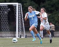 University of North Carolina defender Megan Brigman (3) works to clear ball as Boston College defender Madison Meehan (14) closes.  University of North Carolina (blue) defeated Boston College (white), 1-0, at Newton Campus Field, on October 13, 2013.