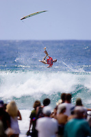 Former world champion ANDY IRONS (Hawaii) comes of his surfboard during his Round 1 heat at the Quiksilver Pro Gold Coast. The day  was full of upsets after the ASP Foster's Top 45 did battle in the three to four foot (1 to 1.2 metre) surf at Snapper Rocks today, March. 1 2007.  IRONS  lost his heat but will surf again in Round two. Photo: Joli